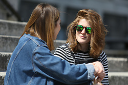 © Licensed to London News Pictures. 04/05/2016. Leeds, UK. A summery looking student enjoys the bright warm sunshine on the steps of Leeds University in West Yorkshire. Britain is experience warmer weather this week with temperatures to rise to 23 degrees celsius this weekend. Photo credit : Ian Hinchliffe/LNP