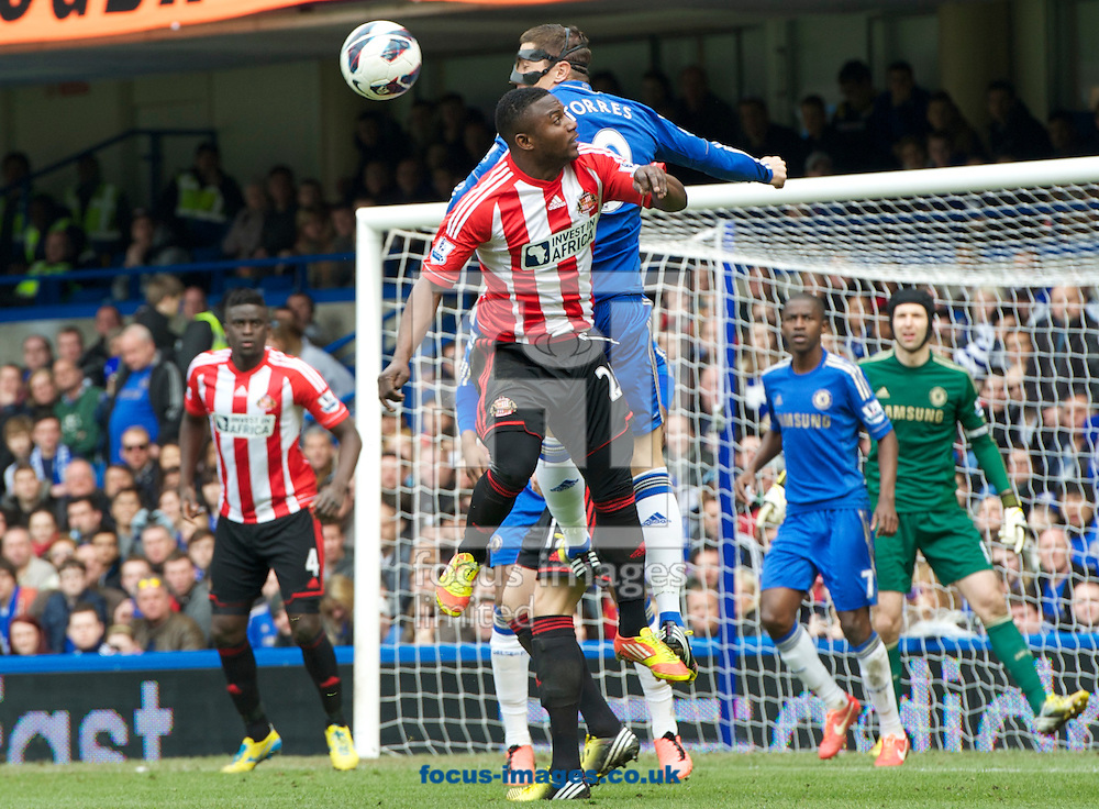 Picture by Alan Stanford/Focus Images Ltd +44 7915 056117.07/04/2013.Fernando Torres of Chelsea is challenged in the air by Stephane Sessegnon of Sunderland during the Barclays Premier League match at Stamford Bridge, London.