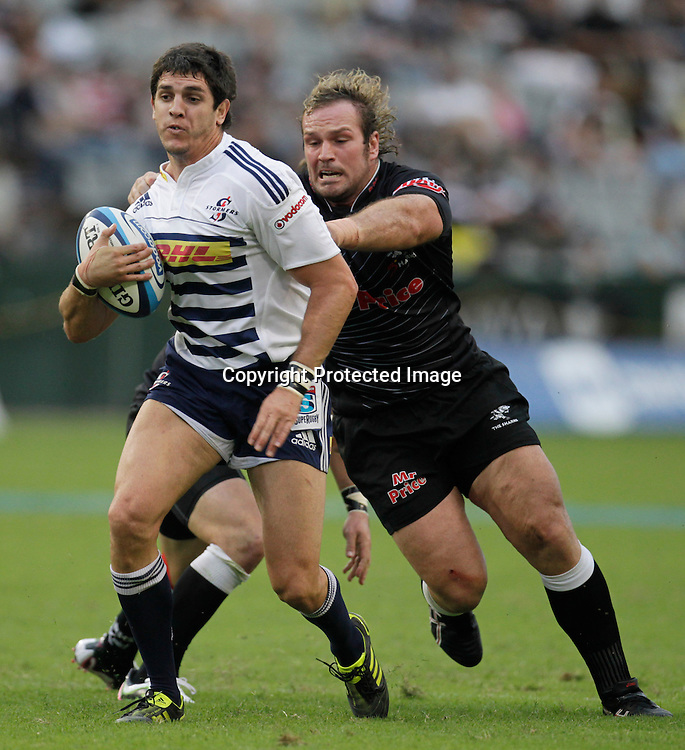 Stormers centre Jaque Fourie is tackled by Sharks player Jannie du Plessis during a Super 15 rugby match in Durban, 2 April , 2011. Sportzpics