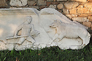 Frieze showing a hunting scene with a man spearing a wild boar from Aphrodisias, Aydin, Turkey. Aphrodisias was a small ancient Greek city in Caria near the modern-day town of Geyre. It was named after Aphrodite, the Greek goddess of love, who had here her unique cult image, the Aphrodite of Aphrodisias. The city suffered major earthquakes in the 4th and 7th centuries which destroyed most of the ancient structures. Picture by Manuel Cohen