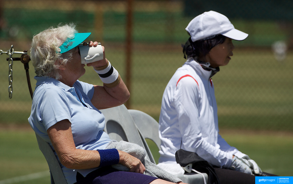 Wilma FitzGerald, Australia enjoys a drink between games during her match against Kazuko Sakagami, Japan, in the 75 Womens Singles during the 2009 ITF Super-Seniors World Team and Individual Championships at Perth, Western Australia, between 2-15th November, 2009.