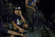 Gold miners' security defending their tunnel from attack by other mine operators for control of a good seam. Mount Diwata, Mindanao, The Philippines.