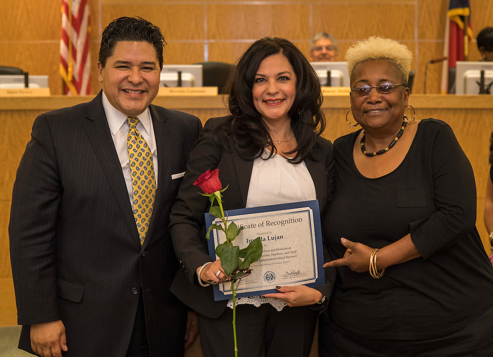 Superintendent Richard Carranza, left, and Wretha Thomas, right, recognize Imelda Lujan, center, during the Houston ISD Board of Trustee meeting, November 10, 2016.