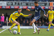 AFC Wimbledon midfielder Scott Wagstaff (7) taking on Southend United midfielder Timothee Dieng (8) during the EFL Sky Bet League 1 match between Southend United and AFC Wimbledon at Roots Hall, Southend, England on 16 March 2019.