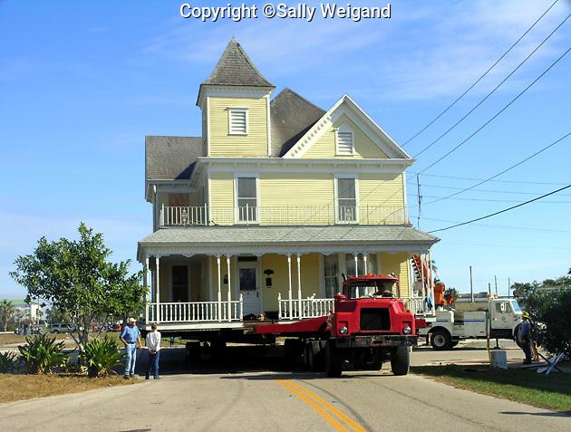 Victorian house on truck moving along street; relocating; Punta Gorda; FL; Florida