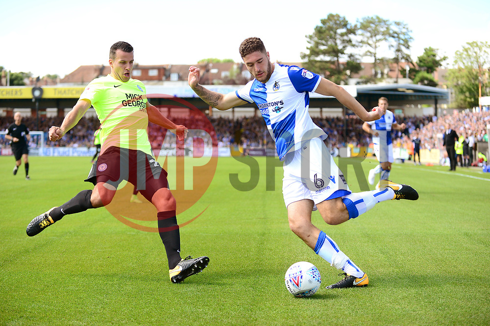 Ryan Sweeney attempts to cross the ball in under pressure from Steven Taylor of Peterborough United - Mandatory by-line: Dougie Allward/JMP - 12/08/2017 - FOOTBALL - Memorial Stadium - Bristol, England - Bristol Rovers v Peterborough United - Sky Bet League One