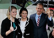 Elizabeth Smart, left, and her mother Lois Smart, center, and her father, Ed Smart, right, wait to address the media outside federal court following a guilty verdict in the Brian David Mitchell trial Friday, Dec. 10 2010 in Salt Lake City. Mitchell was found guilty for the June 5 2002 kidnapping of Elizabeth Smart. (AP Photo/Colin E Braley)