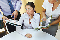 Business woman working with colleagues in office