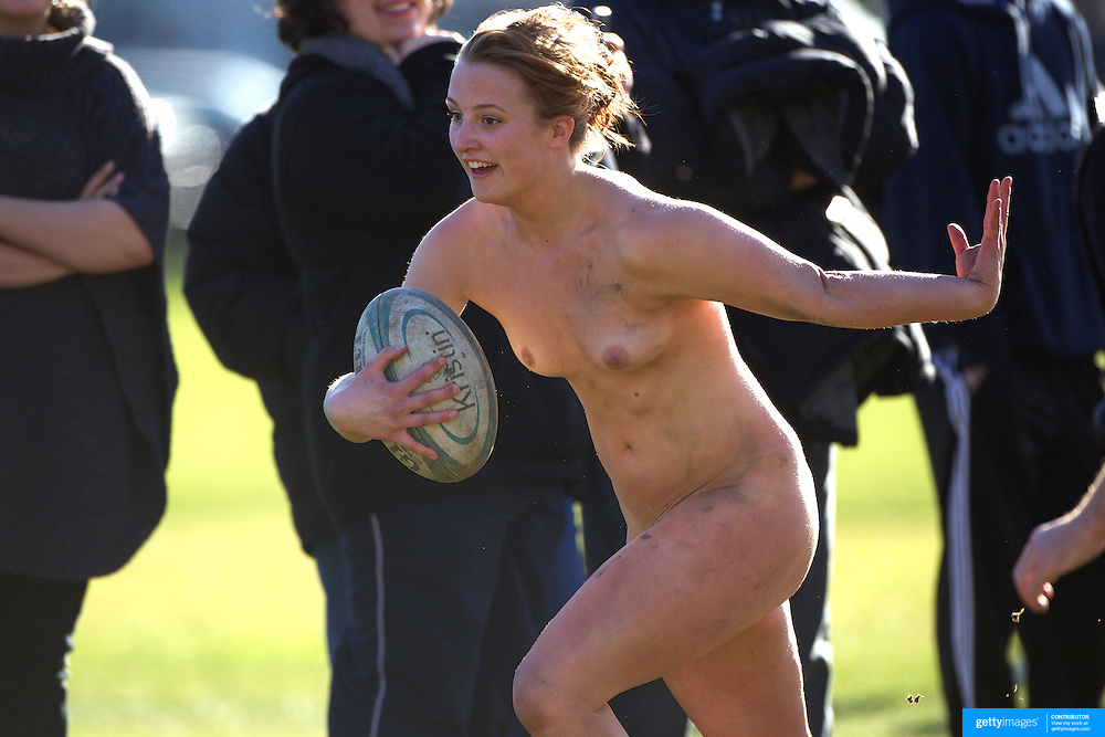 Rachel Scott, 21, from Dunedin in action during the 'Nude Blacks' versus a Fijian invitation side played at Logan Park, Dunedin as an unofficial curtain raiser match before the New Zealand V Fiji test match in Dunedin, New Zealand...The 'Nude Blacks' won the match 20-10 with 21 year old female player Rachel Scott, a member of the Otago women's rugby team named player of the day. .Over 500 people turned up to watch the match which included a blind referee, Julie Woods and three clothed streakers who were ejected from the playing area..The 'Nude Blacks' traditionally play games before test matches in Dunedin and were using this match as a warm up for three nude games planned during the IRB Rugby World Cup in New Zealand with teams from Argentina, Italy, England and Ireland involved.  Matches will be played before World Cup games in Dunedin. New Zealand. 22nd July 2011. Photo Tim Clayton