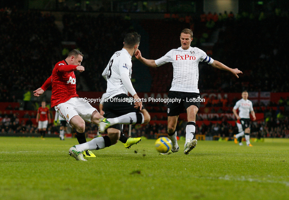 26 January 2013 FA Cup Manchester United v Fulham.<br /> WAyne Rooney scores the 2nd United goal.<br /> Photo: Mark Leech.