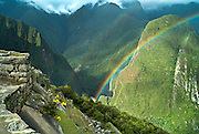 PERU, MACHU PICCHU:  Double rainbow over the ancient Inca terraces of Machu Picchu with the Urubamba River, mountains and valley in the background. Machu Picchu is a pre-Columbian Inca site located 2,430 metres (8,000 ft) above sea level. It was built around 1460 AD but was abandoned as an official site for the Inca rulers a hundred years later, at the time of the Spanish conquest of the Inca Empire.