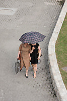 two women walk under umbrella in Shanghai China