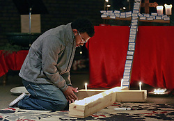 November 28, 2016 - Columbus, OH, USA - A student lights a candle inside a cross during a prayer vigil that was held on Monday, Nov. 28, 2016 at Jacob's Porch, the Lutheran Campus Ministry at Ohio State University, after a man attacked pedestrians with a car and then a knife, injuring nine people. (Credit Image: © Barbara J. Perenic/TNS via ZUMA Wire)