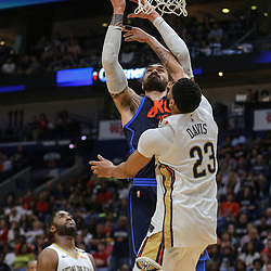 Apr 1, 2018; New Orleans, LA, USA; Oklahoma City Thunder center Steven Adams (12) shoots over New Orleans Pelicans forward Anthony Davis (23) during the second quarter at the Smoothie King Center. Mandatory Credit: Derick E. Hingle-USA TODAY Sports