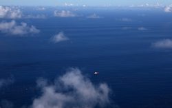 INDIAN OCEAN 27APR13 - The Greenpeace ship Esperanza appears inbetween cloud formations in the Indian Ocean.<br /> <br /> The Greenpeace ship Esperanza is on patrol documenting fishing activities in the Indian Ocean.<br /> <br /> jre/Photo by Jiri Rezac / Greenpeace