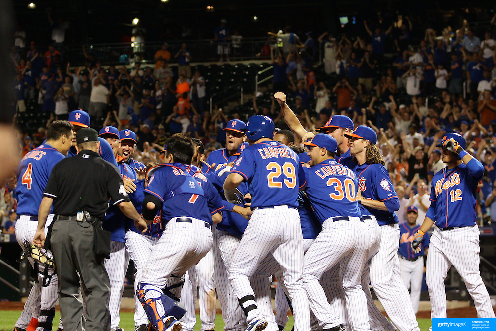 Wilmer Flores, New York Mets, hits the game winning walk off home run in the 12th inning for the Met 2-1 win during the New York Mets Vs Washington Nationals MLB regular season baseball game at Citi Field, Queens, New York. USA. 31st July 2015. Photo Tim Clayton