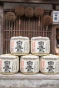 Sake barrels in front of a sake distillery and restaurant.