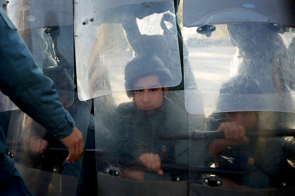 Afghan National Police (ANP) cadets train riot control during morning exercises at the Afghan Nacional Police Academy in Kabul. ANP Academy trains 1250 cadets at the time during a period of four years. Every year, five hundred new recruits are selected, out of more than nine thousand of candidates, to join the academy and other five hundred graduate. Fifteen per cent of the recruits are women.