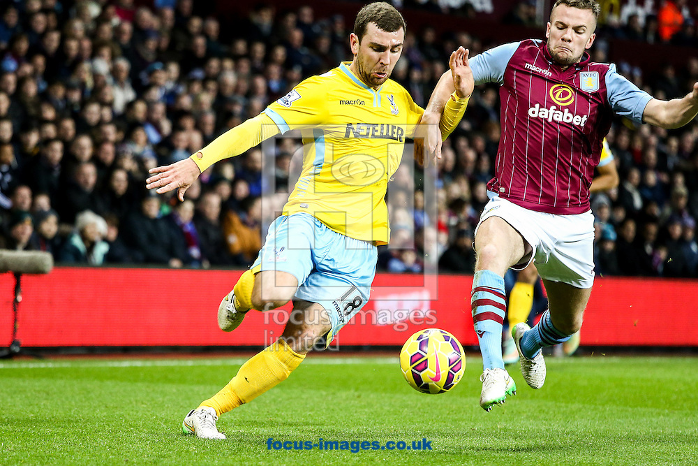 James McArthur of Crystal Palace (left) under pressure from Tom Cleverley of Aston Villa (right) during the Barclays Premier League match at Villa Park, Birmingham<br /> Picture by Andy Kearns/Focus Images Ltd 0781 864 4264<br /> 01/01/2015