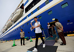 A LGBTs (lesbian, gay, bisexual and transgender) tour leader leads members disembarking the cruise organised by the Parents and Friends of Lesbians and Gays (PFLAG) China organisation at Sasebo, Nagasaki, Japan, 16 June 2017. About 800 members of the Chinese LGBT (lesbian, gay, bisexual and transgender) community and their parents spent four days on a cruise trip organised by Parents and Friends of Lesbians and Gays (PFLAG) China, a grassroots non-government organisation, celebrating the 10th anniversary of the organisation. It aims to promote coexistence among homosexuals and their families.