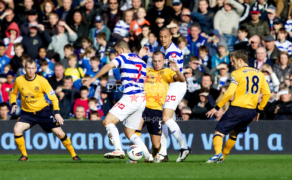 LONDON, ENGLAND - Saturday, March 3, 2012: Everton's John Heitinga in action against Queens Park Rangers' Adel Taarabt during the Premiership match at Loftus Road. (Pic by Vegard Grott/Propaganda)