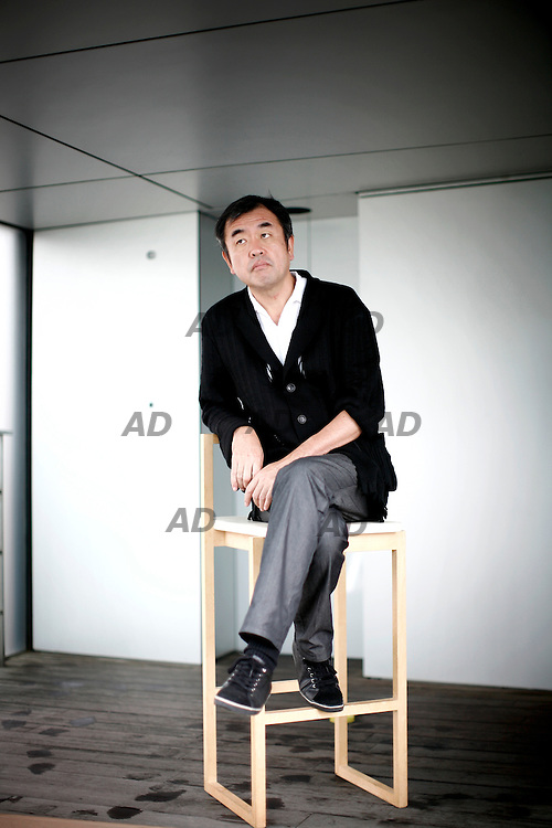 Kengo Kuma, one of the most heralded of a new generation of Japanese architects,  born in Japan in 1954, graduated from the school of engineering at the university of Tokyo in 1979, and continued his studies in New York in 1985-86, at Columbia university. The following year, he founded the ?spatial design? studio and, in 1990, ?kengo kuma & associates?; between 1998 and 1999, he was a professor at the faculty of environmental information at Keio university. Kuma's work is characterized by a delicate simplicity and minimalism, incorporating a wide range of ephemeral transparencies. Their ineffable vibrancy is achieved largely by the extensive and skillful use of screens: metal, wooden, bamboo, and even stone louvers or slates, as well as paper, plastic, and glass surfaces or membranes. His use of new, sophisticated, and efficient technologies, his sensitivity to site, and his attention to the ecological and prevailing social context of his work are all explored in Kengo Kuma. *** Local Caption *** Mr. Kengo Kuma.