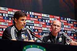 DINARD, FRANCE - Sunday, July 3, 2016: Wales' head of pubic affairs Ian Gwyn Hughes and manager Chris Coleman during a press conference at their base in Dinard as they prepare for the Semi-Final match against Portugal during the UEFA Euro 2016 Championship. (Pic by David Rawcliffe/Propaganda)