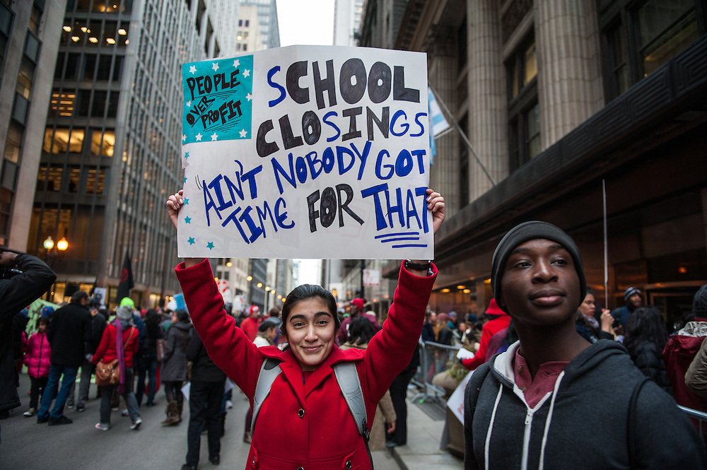 Students, parents, and teachers rally in downtown Chicago in opposition of the closing of 53 Chicago public schools.