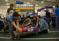 "The Interlakes ""Lakerbots"" team readies their robot for their first time competing in the Governor's Cup FirstNH Robotics on Saturday in the All Well North complex at PSU.   Team members  Peter Borsh, Adian LeBlanc, Coach/Mentor Joe Derrick, Eli Misavage, Olivia Richards and Haley Pimley.   (Karen Bobotas/for the Laconia Daily Sun)"