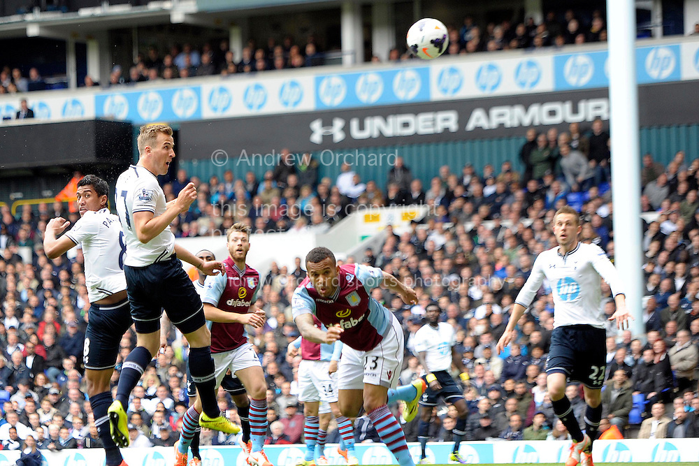 Tottenham Hotspur's Harry Kane (2nd left) heads the ball . Barclays premier league match ,Tottenham Hotspur v Aston Villa at White Hart Lane in Tottenham, London  on Sunday 11th May 2014.<br /> pic by John Patrick Fletcher, Andrew Orchard sports photography.