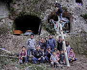 Family members pose for a portrait after adding a new layer of fabric to wrap the remains of a relative in Barrupu. In this district of Toraja, the body is not buried but placed in a hole carved into a cliff. <br /> <br /> Ma'nene is a tradition that takes place in August after harvest where the bodies of the dead loved ones are exhumed to be cleaned, groomed and dressed. For most, it's a bittersweet moment, a chance to reunite and physically see and touch and reconnect with loved ones who had passed on.