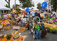 Merrick, New York, USA. 13th September 2014. Families visit the 23rd Annual Merrick Fall Festival & Street Fair in suburban Long Island, which had colorful decorations for the autumn holidays Halloween and Thanksgiving on display for sale.