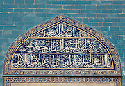 Iznik tiles with Arabic inscriptions on the exterior wall of the Green Tomb or Yesil Turbe, mausoleum of the 5th Ottoman Sultan Mehmed I Celebi, Bursa, Turkey. The tomb was built by Mehmed's son and successor Murad II following Mehmed's death in 1421 and is so named because of the green-blue tiles which cover the exterior. The architect, Haci Ivaz Pasha, designed the tomb and the Yesil Mosque opposite. Most of the exterior tiles were replaced following an earthquake in 1855. Picture by Manuel Cohen
