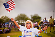12 JUNE 2010 - PHOENIX, AZ: Dorothy Hall from Phoenix, AZ, cheers for former Congressman Tom Tancredo (R-CO)during his speech in support of SB 1070 at Bolin Memorial Park near the State Capitol in Phoenix Saturday. About 500 people, many from California and Florida, came to Bolin Memorial Park in Phoenix Saturday. The pro SB 1070 rally was sponsored by Tea Party.   PHOTO BY JACK KURTZ