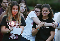 Students grieve during a candlelight vigil at Memory Mall on the UCF campus in Orlando, FL, USA, in commemoration of the one-year anniversary of the mass shooting at Marjory Stoneman Douglas High School, on Thursday, February 14, 2019. Photo by Stephen M. Dowell/Orlando Sentinel/TNS/ABACAPRESS.COM
