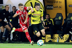 DORTMUND, Aug. 6, 2017  Dortmund's Christian Pulisic (R) vies with Bayern Munich's Joshua Kimmich during the 2017 German Super Cup match between Bayern Munich and Borussia Dortmund in Dortmund, Germany, on Aug. 5, 2017. Bayern Munich won 7-6 after penalty shootout and got the 2017 German Super Cup trophy. (Credit Image: © Joachim Bywaletz/Xinhua via ZUMA Wire)