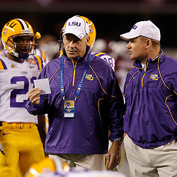 Jan 7, 2011; Arlington, TX, USA; LSU Tigers head coach Les Miles talks with offensive coordinator Gary Crowton prior to kickoff against the Texas A&M Aggies in the 2011 Cotton Bowl at Cowboys Stadium.  Mandatory Credit: Derick E. Hingle