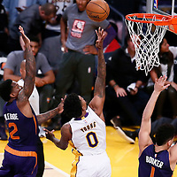 06 November 2016: Los Angeles Lakers guard Nick Young (0) goes for the layup past Phoenix Suns guard Eric Bledsoe (2) during the LA Lakers 119-108 victory over the Phoenix Suns, at the Staples Center, Los Angeles, California, USA.