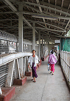 YANGON, MYANMAR - CIRCA DECEMBER 2013: Passenger walks at the at the Yangon Central Railway Station