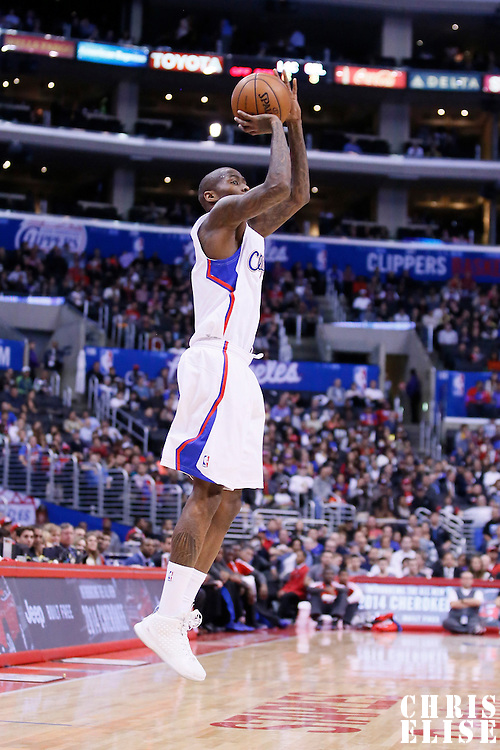 06 January 2014: Los Angeles Clippers shooting guard Jamal Crawford (11) takes a jumpshot during the Los Angeles Clippers 101-81 victory over the Orlando Magic at the Staples Center, Los Angeles, California, USA.