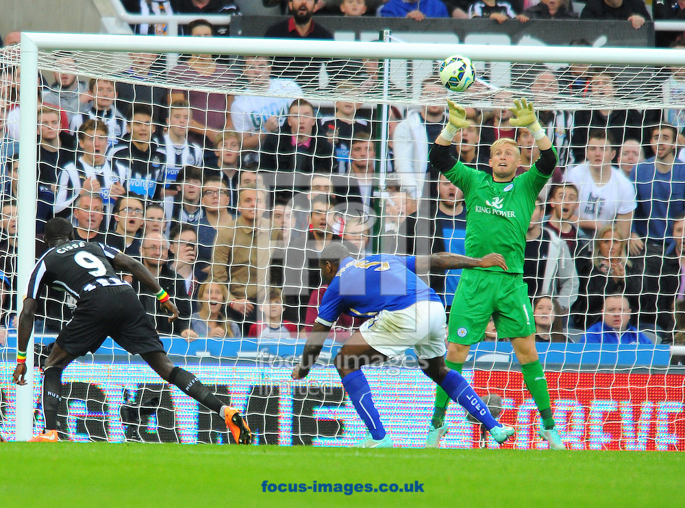 Papiss Cisse of Newcastle United (left) heads the ball but misses a chance during the Barclays Premier League match at St. James's Park, Newcastle<br /> Picture by Greg Kwasnik/Focus Images Ltd +44 7902 021456<br /> 18/10/2014