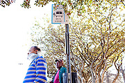 Ronald Jackson (left) and Charles Waters wait at the Southlake Mall CTRAN bus stop March 31, 2010. Mr. Waters takes the bus almost every day to get to his job at the mall. He said he would have to try to find a ride to work April 1, 2010. March 31, 2010 marked Clayton County, Georgia's last day of the county's public bus system, CTRAN, running.