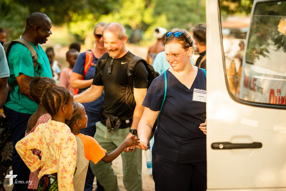 Team members depart for their accommodations following the second day of the LCMS Mercy Medical Team on Tuesday, May 8, 2018, in the Yardu village outside Koidu, Sierra Leone, West Africa. LCMS Communications/Erik M. Lunsford