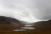 Landscape of distant moorland waters on Glen More, Isle of Mull, Scotland.