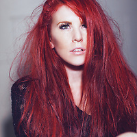 Young woman with red disheveled hair