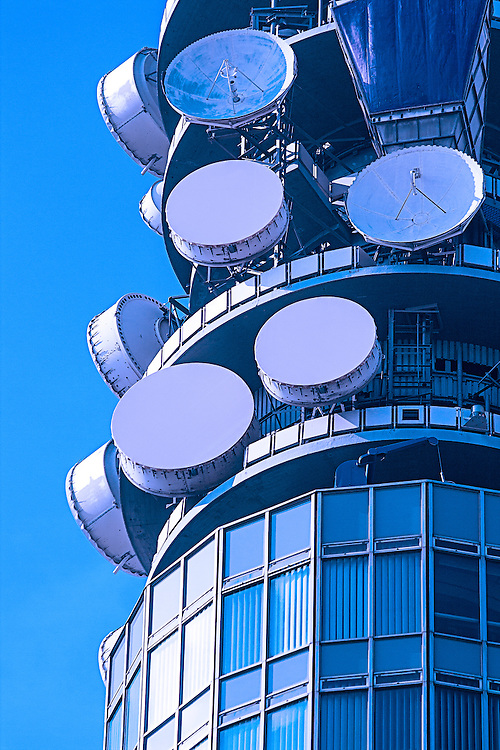 Telecommunication dishes attached to a building
