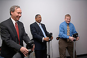 Dean Shepard, Dr. McDavis, John Bowditch....Ohio University GRID Lab Celebrates Grand Opening.. .ATHENS, Ohio-The Game Research and Immersive Design (GRID) Lab, an initiative of the College of Communication at Ohio University, opened on Feb. 8, at ?5 on Court Street? in Athens. Though the research aspect of the lab has been functional since September 2005, today marks the opening of the state-of-the-art arcade, which is open to Ohio University students and the community.. .The goal of the GRID Lab is to provide the Appalachian Ohio region with training, education, and an opportunity to develop technical and creative skills through the use of interactive digital game technology, according to College of Communication Dean Greg Shepherd. The GRID Lab also serves as an innovative and creative center for undergraduate, graduate, faculty and staff research and project development.. .?We intend to make the College of Communication at Ohio University a leader in the area of interactive digital technology, both in curriculum and in research,? Shepherd said. ?The GRID Lab will showcase this leadership for us.?. .The primary focus of the facility is on ?serious games? and three-dimensional simulation and virtuality. Serious games are those created for education, simulation and training purposes. These games are widely used throughout academia, healthcare and wellness, military, government, and economic and social development. The GRID Lab provides Ohio University with the resources and tools to create such interactive digital media and technologies.. .?The GRID Lab will contribute to the field in ways that do not respond to but instead introduce major technological innovations and research,? said GRID Lab Director Karen Riggs. ?These contributions will be powered by partnerships on and off campus. We can collaborate with the Colleges of Osteopathic Medicine and Health and Human Services, for example, to do path-breaking projects in medical and physiological simulation. The GR