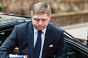 Robert Fico, Prime Minister of Slovakia arrives tired at a EU Budget summit at the European Council building after a break in Brussels, Friday, Feb. 8, 2013. A European Union summit to decide EU spending for the next seven years entered a second day after all-night negotiations left a standoff over spending unresolved. The leaders of the 27 nations inched toward a compromise Friday that would leave their common budget with a real-term cut for the first time in the EU's history.