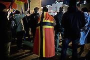 Frankfurt am Main | 02 Feb 2015<br /> <br /> Am Montag (02.02.2015) demonstrierten in Frankfurt an der Hauptwache etwa 60 PEGIDA-Anh&auml;nger mit teils extrem rassistischen Reden und Parolen z.B: gegen &quot;Islamisierung&quot;, an den Aktionen gegen die Rechtsextremisten nahmen mehrere tausend Menschen teil.<br /> Hier: Teilnehmer der PEGIDA-Demo einer Flagge, die vom Deutschen Kolleg f&uuml;r das 4. Reich entworfen wurde.<br /> <br /> &copy;peter-juelich.com<br /> <br /> [No Model Release | No Property Release]