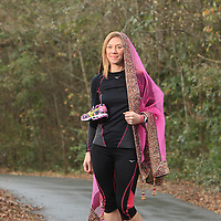"Meghan Lyons poses for a portrait on Summer Rest Trail in Wilmington, N.C. wearing a Dupetta, a traditional Indian Wedding Veil. Lyons, who is running the Quintiles Wrightsville Beach Marathon for the 5th time on March 16th is also planning a traditional Hindu wedding for May 3rd. Running the marathon every year is a ""life goal"" says Lyons who has ran the marathon every year since it was started. (Jason A. Frizzelle)"
